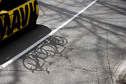 Shadows of the neutral service car at the Liege-Bastogne-Liege Femmes - a 135.5 km road race between Bastogne and Ans on April 23 2017 in Liège, Belgium.