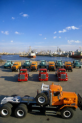 Fleet of heavy transport vehicles on a dock at the Port of Houston