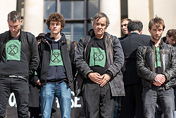 May 12, 2019 - Paris, France - Members of the international social movement Extinction Rebellion France (XR) pose during an action at the Trocadero this Sunday, May 12, 2019 in Paris. For the occasion, activists spilled several tens of liters of fake blood on the steps of the Trocadero to raise public awareness of the dangers of the 6th mass extinction that affects the fauna of planet earth. (Credit Image: © Samuel Boivin/NurPhoto via ZUMA Press)