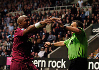 Photo: Jed Wee.<br /> Newcastle United v Bolton Wanderers. The Barclays Premiership. 15/10/2006.<br /> <br /> Referee Alan Wiley (R) is flung aside as he tries to stop Bolton's El Hadji Diouf taunting the home fans after he scored.