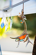 Art antlers hanging from tent, Ritter Island, Thousand Springs Art Festival, Hagerman, Idaho.