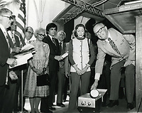 1977 Jerry Fairbanks places an item in the time capsule in the forecourt of Grauman's Chinese Theater
