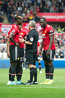Football - 2017 / 2018 Premier League - Swansea City vs. Manchester United<br /> <br /> Referee Jonathan Moss speaks to Paul Pogba of Manchester United—<br /> , at Liberty Stadium.<br /> <br /> COLORSPORT/WINSTON BYNORTH