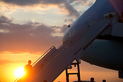 President Barack Obama boards Air Force One at Yangon International Airport for departure from Burma en route to Australia, Nov. 14, 2014. (Official White House Photo by Chuck Kennedy)<br /> <br /> This official White House photograph is being made available only for publication by news organizations and/or for personal use printing by the subject(s) of the photograph. The photograph may not be manipulated in any way and may not be used in commercial or political materials, advertisements, emails, products, promotions that in any way suggests approval or endorsement of the President, the First Family, or the White House.
