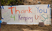 A banner, thanking firefighters battling a wildfire, is hanged at the intersection of streets, Monday, Sept. 4, 2017, in the Sunland-Tujunga of Los Angeles, the United States, on Sept. 4, 2017. More than 1,000 firefighters work for a fourth day to put out a 7,000-acre brushfire that is 30 percent contained, as the last of the residents ordered to evacuate the record-setting blaze were expected to<br /> return to their homes authorities said. (Xinhua/Zhao Hanrong)(Photo by Ringo Chiu)<br /> <br /> Usage Notes: This content is intended for editorial use only. For other uses, additional clearances may be required.