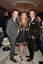 LONDON, ENGLAND 8 DECEMBER 2016: Raynald Aeschlimann, Eddie Redmayne, Hannah Redmayne at the Omega Constellation Globemaster Dinner at Marcus, The Berkeley Hotel, Wilton Place, London England. 8 December 2016.