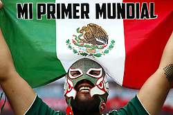 A Mexico fan celebrates his sides win after the final whistle