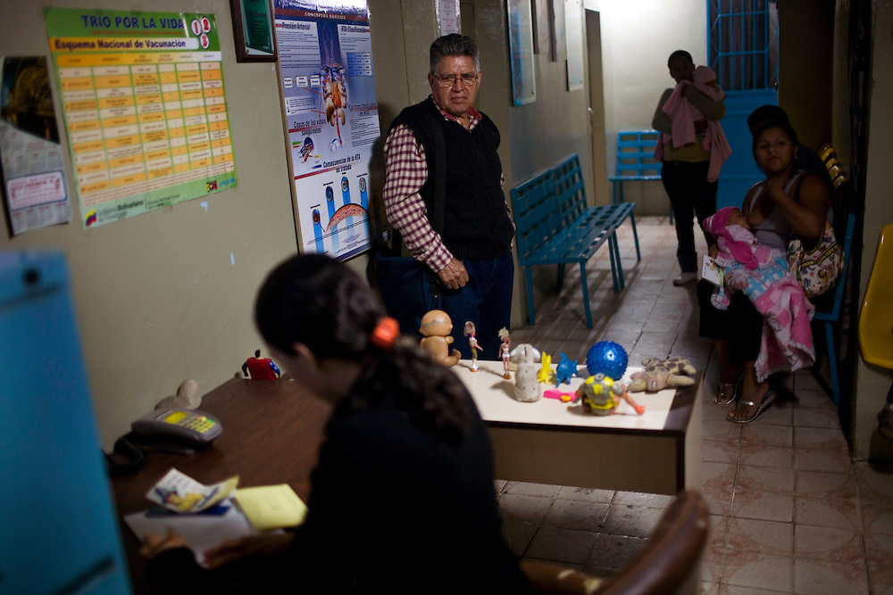 Maximo Lobato signs in at Dr. Carlos Serrano's clinic  in Petare, one of the largest and most dangerous slums of Caracas.  Lobato has high cholesterol and Dr. Serrano prescribed Lipitor and two other drugs. He says that he does not have enough money to buy all three medicines and will probably only buy Lipitor right now. Pfizer is trying to increase their market share in the slums and are targeting clinics, hospitals and pharmacies, sending sales representatives to the far reaches of the slum.