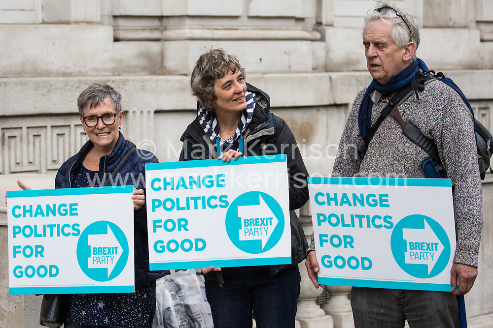London, UK. 7 May, 2019. Activists from the Brexit Party protest outside the Cabinet Office during cross-party Brexit talks between representatives of the Government including Deputy Prime Minister David Lidington and Environment Secretary Michael Gove, and representatives of the Labour Party including Shadow Chancellor John McDonnell and Shadow Secretary of State for Exiting the European Union Sir Keir Starmer. Talks resume tomorrow.