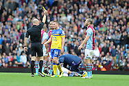 Everton's James McCarthy © is booked by referee Anthony Taylor after he had fouled Aston Villa's Ashley Westwood (on ground). Barclays Premier League, Aston Villa v Everton at Villa Park in Aston, Birmingham on Saturday 26th Oct 2013. pic by Andrew Orchard, Andrew Orchard sports photography,