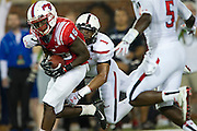 DALLAS, TX - AUGUST 30: Jeremy Johnson #15 of the SMU Mustangs is tackled by Terrance Bullitt #1 of the Texas Tech Red Raiders on August 30, 2013 at Gerald J. Ford Stadium in Dallas, Texas.  (Photo by Cooper Neill/Getty Images) *** Local Caption *** Jeremy Johnson; Terrance Bullitt