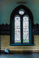 Indonesia, Sumatra. Medan. Medan's Great Mosque, Masjid Raya. An old man inside the mosque, sleeping or meditating?