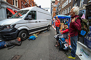 Four activists locked themselves below a van in St Martins Lane near Covent Garden in central London on Monday, Aug 23, 2021. This is a two week planned of action against new fossil fuel investments. XR protestors are aiming to occupy parts of central London for two weeks from Monday, aiming to force the Government to halt all new investment in fossil fuels. (VX Photo/ Vudi Xhymshiti)