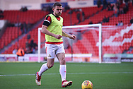 Andrew Butler of Doncaster Rovers (6) warming up during the EFL Sky Bet League 1 match between Doncaster Rovers and AFC Wimbledon at the Keepmoat Stadium, Doncaster, England on 17 November 2018.