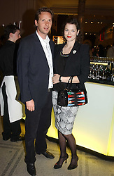 Model JASMINE GUINNESS and GAWAIN RAINEY at a party to celebrate the publication of  'Put On Your Pearl Girls!' by Lulu Guinness held at the V&A museum, London on 5th May 2005.<br /><br />NON EXCLUSIVE - WORLD RIGHTS