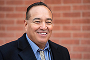 Quincy Natay, Superintendent of Chinle Unified School District stands for a portrait.