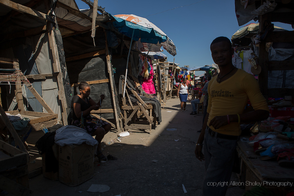 Vendors sell their wares in front of the former Topolino shopping center-- leveled in the 2010 quake-- in downtown Port-au-Prince, Haiti, January 4, 2015.  The area remains one of the main shopping areas in downtown Port-au-Prince, and is still called Topolino, but the commerce has moved to the street.
