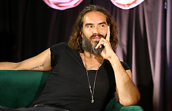 """Russell Brand releases a photo on Twitter with the following caption: """"""""Check out today&#39;s #UnderTheSkin podcast with the great @radhanathswami - recorded live in Co.Wicklow, Ireland.<br /> <br /> """"Practical Spirituality - More Than Crystals and Candles""""<br /> 🎧 Desktop: https://t.co/1FfyOXN2up <br /> 🎙️Spotify: https://t.co/HTAjsufjEw <br /> 🍏 iTunes: https://t.co/fX0RDpocXM"""""""". Photo Credit: Twitter *** No USA Distribution *** For Editorial Use Only *** Not to be Published in Books or Photo Books ***  Please note: Fees charged by the agency are for the agency's services only, and do not, nor are they intended to, convey to the user any ownership of Copyright or License in the material. The agency does not claim any ownership including but not limited to Copyright or License in the attached material. By publishing this material you expressly agree to indemnify and to hold the agency and its directors, shareholders and employees harmless from any loss, claims, damages, demands, expenses (including legal fees), or any causes of action or allegation against the agency arising out of or connected in any way with publication of the material."""