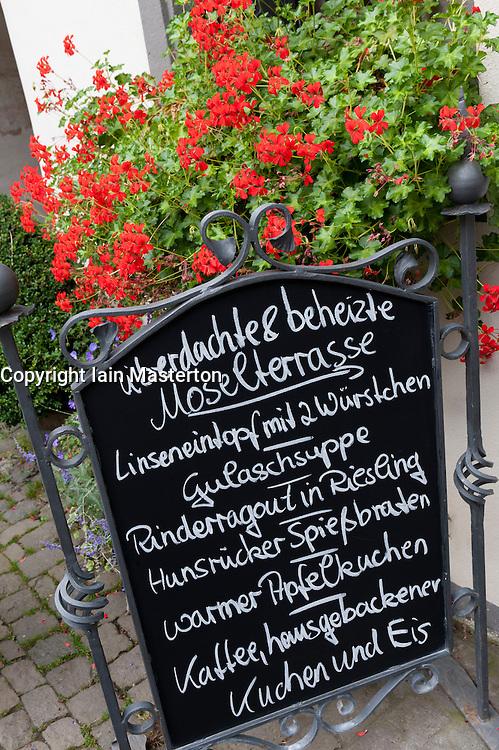 Menu board at restaurant in Beilstein village on River Mosel in Rhineland-Palatinate Germany