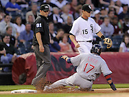 CHICAGO - JUNE 05:  Shin-soo Choo #17 of the Cleveland Indians slides into third base after advancing on an error against the Chicago White Sox on June 5, 2009 at U.S. Cellular Field in Chicago, Illinois.  The Indians defeated the White Sox 6-0. (Photo by Ron Vesely)