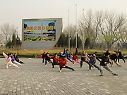people practicing Taichi at the entrance to Chaoyang park Beijing China