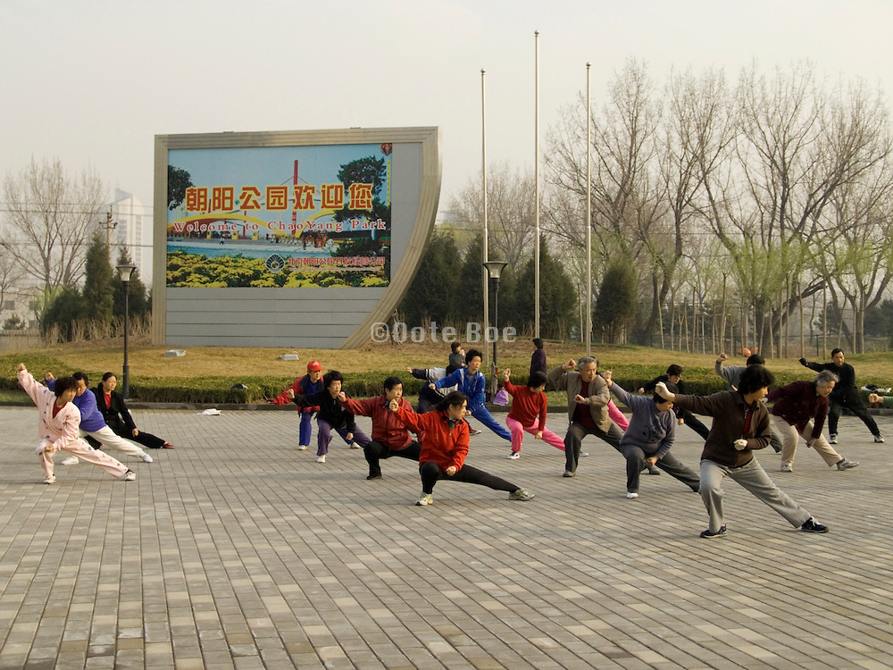 people practicing Taichi at the entrance to Chaoyang park Beijing China