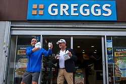 © Licensed to London News Pictures. 05/10/2021. London, UK. Two men outside a branch of Greggs in north London. Greggs, the bakery chain, warns of price increases of sausage rolls, pasties and steak bakes following the coronavirus and supply chain crises. Photo credit: Dinendra Haria/LNP