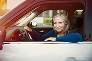 Mature women sitting in drivers seat