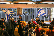 Anti-Netanyahu protesters wave Israeli flags, as they demonstrate in front of the Israeli Presidential Residence , Israel, April 03, 2021. Several dozens marched from the formal Prime Minister residence to the Presidential residence in the Israeli capital. The Evidence stage of Israeli Prime Minister Benjamin Netanyahu's trial will begin April 5, 2021. The PM is charged by the Israeli State Attorney's Office with sections of fraud, bribery, and breach of trust.
