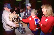 Christmas food shelf volunteers handing out gifts age 20 and 45.  Minneapolis Minnesota USA
