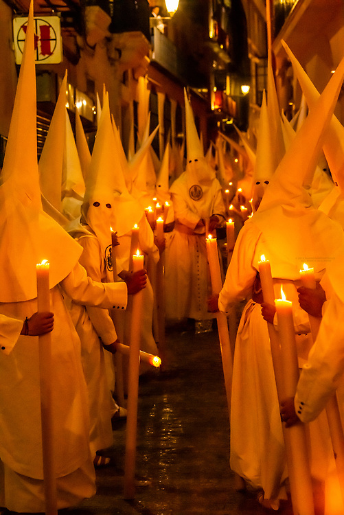 Hooded Penitents (Nazarenos) in the procession of the Brotherhood (Hermandad) La Candelaria, Holy Week (Semana Santa), Seville, Andalusia, Spain.