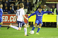 AFC Wimbledon attacker Harry Forrester (11) with a shot during the EFL Trophy match between AFC Wimbledon and Tottenham Hotspur at the Cherry Red Records Stadium, Kingston, England on 3 October 2017. Photo by Matthew Redman.