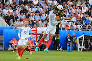 Chris Smalling of England jumps to block a header from Gareth Bale of Wales. UEFA Euro 2016, group B , England v Wales at Stade Bollaert -Delelis  in Lens, France on Thursday 16th June 2016, pic by  Andrew Orchard, Andrew Orchard sports photography.