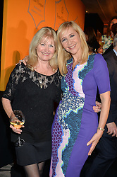 Left to right, DEBBIE MOORE and TANIA BRYER at the Veuve Clicquot Business Woman Awards held at Claridge's, Brook Street, London on 11th May 2015.