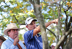 September 21, 2017 - Atlanta, GA, USA - Justin Rose gets a ruling from an official after hitting his drive into the woods on the 1st hole in the opening round of the Tour Championship on Thursday, Sept. 21, 2017, at Eastlake Golf Club in Atlanta. (Credit Image: © Curtis Compton/TNS via ZUMA Wire)