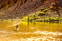 A fisherman casts his line on a sunny cold morning on the White River just outside of Aspen, Colorado.