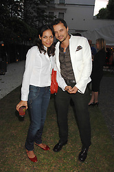 Actress ROSARIO DAWSON and GERRY DEVEAUX at a party to celebrate Le Touessrok a luxury resort in Mauritius, held at The Hempel, 31-35 Craven Hill Gardens, London W2 on 12th June 2007.<br /><br />NON EXCLUSIVE - WORLD RIGHTS