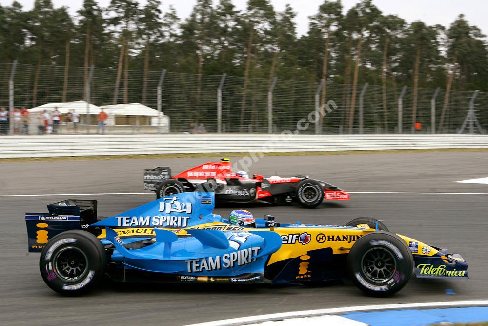 Giancarlo Fisichella (Renault) passing Markus Winkelhock (Midland-Toyota) during Friday's practice for the 2006 German Grand Prix at Hockenheim. Photo: Grand Prix Photo