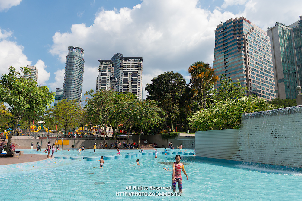 Kids Play In Kuala Lumpur City Center Park Pool, Malaysia