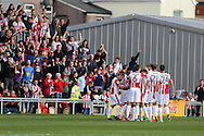 Asa Hall of Cheltenham Town (hidden) celebrates with his teammates after he scores his teams 1st goal. EFL Skybet football league two match, Newport county v Cheltenham Town at Rodney Parade in Newport, South Wales on Saturday 10th September 2016.<br /> pic by Andrew Orchard, Andrew Orchard sports photography.