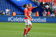 Gareth Bale of Wales  celebrates with his daughter Alba Violet at the end of the match as Wales win 1-0 to book a place in the quarter-finals. UEFA Euro 2016, last 16 , Wales v Northern Ireland at the Parc des Princes in Paris, France on Saturday 25th June 2016, pic by  Andrew Orchard, Andrew Orchard sports photography.