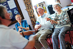 Elderly people participate in chair exericises during a health promotion day run by the Bradford Council, Ilkley, West Yorkshire