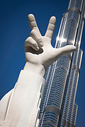 Win Victory Love hand sculpture on the banks of the Burj Khalifa Lake. It symbolizes work ethic, success, and love of the nation and has become a trademark of the UAE. Coined by His Highness Sheikh Mohammed bin Rashid Al Maktoum