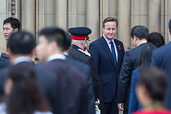 © Licensed to London News Pictures . 23/10/2015 . Manchester , UK . British Prime Minister DAVID CAMERON outside Manchester Town Hall as Chinese president , Xi Jinping arrives to visit Manchester as part of his state visit to the United Kingdom . Photo credit: Joel Goodman/LNP
