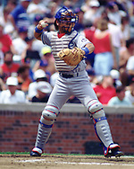 CHICAGO - 1993:  Mike Piazza of the Los Angeles Dodgers catches during an MLB game versus the Chicago Cubs at Wrigley Field in Chicago, Illinois during the 1993 season. (Photo by Ron Vesely) Subject:   Mike Piazza