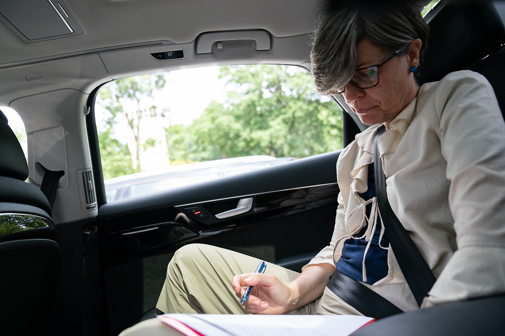 Ambassador Lone Dencker Wisborg reviews notes prior to her meeting with DC Director of Energy and Environment, Tommy Wells, near Capitol Hill.