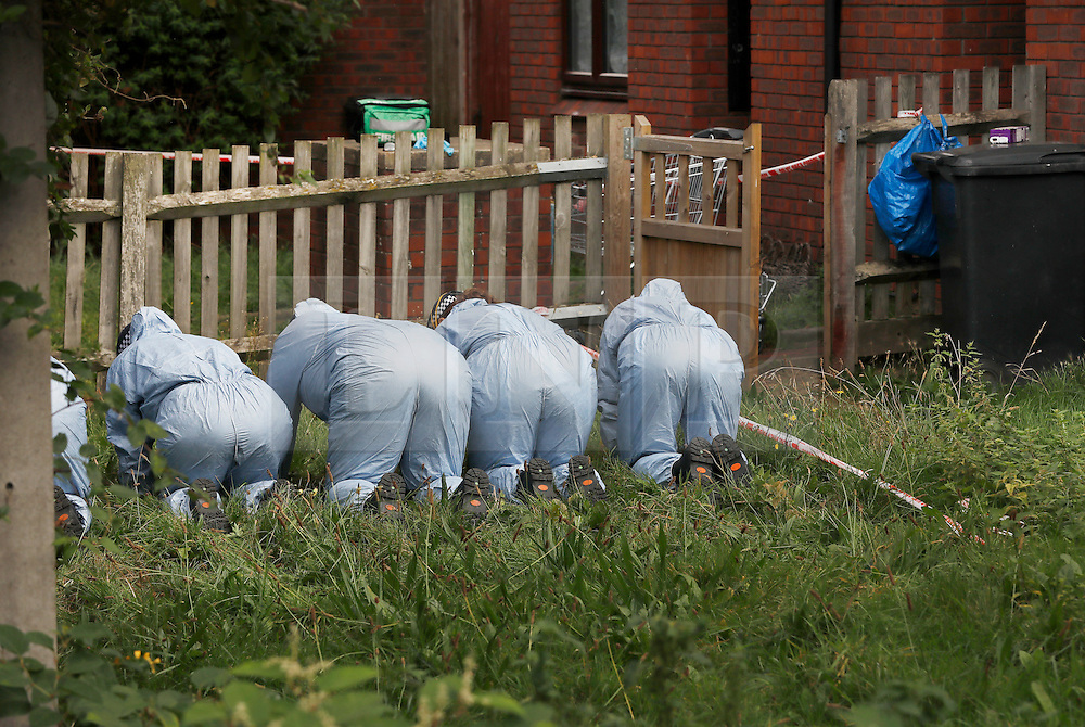 © Licensed to London News Pictures. 08/10/2016. London, UK. Police search part of a garden near the scene of a shooting in Eastney Road, Croydon. Police were called to reports of a man suffering a gunshot wound at 11.30 PM on Friday night. Officers from the Homicide and Major Crime Command are investigating after the man was pronounced dead at the scene.Photo credit: Peter Macdiarmid/LNP