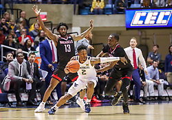 Dec 14, 2019; Morgantown, WV, USA; West Virginia Mountaineers guard Brandon Knapper (2) is pressured by Nicholls State Colonels guard Andre Jones (13) and Nicholls State Colonels guard Dexter McClanahan (22) during the first half at WVU Coliseum. Mandatory Credit: Ben Queen-USA TODAY Sports