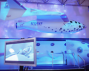 A computer-generated astronaut lies down on board a space flight on Virgin Galactic's  SpaceShipTwo's,  unveiled as a replica model during Wired NextFest at the Jacob K. Javits Convention Center, New York. Under construction by Burt Rutan in Mojave, California and looking more like '2001 A Space Odyssey,' than future everyday holidays, SpaceShipTwo is a re-usable orbiting vehicle that will become an important tool for Man's leisure time in space when affordable commercial space tourism starting in 2009/10. Aboard the space vehicle will be 6 passengers, each paying $200,000 for the 40 minute flight to 360,000 feet (109.73km, or 68.18 miles) and to experience 6 minutes of weighlessness. From these circular portholes, astronauts will see 1,000 miles having taken off from the new Spaceport America, New Mexico. .