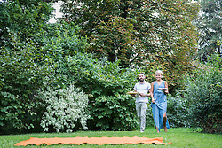 Young couple carrying food and walking at picnic blanket, Bavaria, Germany